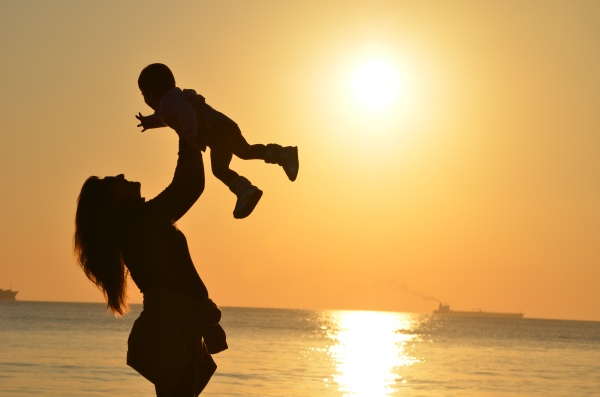 Silhouette of Mother and Daughter at Sunset