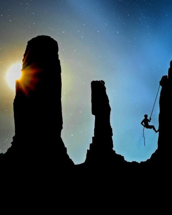 Silhouette of mountain climber